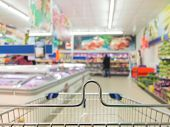 stock photo of grocery cart  - View from shopping cart trolley basket at supermarket self - JPG