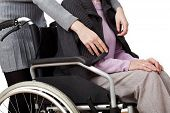 stock photo of disability  - Disabled woman is cared by her daughter - JPG
