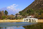 stock photo of jade  - Black Dragon Pool Jade Dragon Snow Mountain in Lijiang - JPG