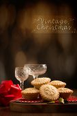 Festive mince pies with vintage Christmas background