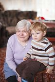 Great-grandmother With Toddler And Her Grandson, Indoor