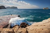 Stone Breakwater With Breaking Waves. Montenegro, Adriatic Sea