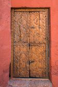 wooden door in Santa Catalina monastery in the peruvian Andes at Arequipa Peru