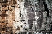 Angkor Wat Cambodia. Bayon temple in Angkor Thom historical place. Human face and figures murals and