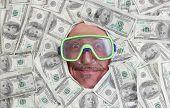 Man Diving In Dollar Notes