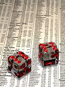 Two crystal dice over stock market quotes - shallow depth of field with focus on the dice