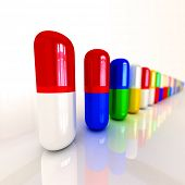 Colorful pills aligned in a row with shallow depth of field