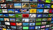 Big installation of Flat Panel TVs displaying different images