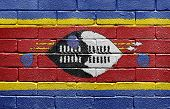 Flag of Swaziland painted onto a grunge brick wall