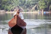 Man In Traditional, Wooden Boat On African River