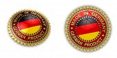 Two shiny seals with Made in Germany text on them over white background