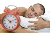 Man Asleep With Clock