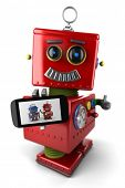 Happy vintage toy robot with smartphone and thumbs up over white background