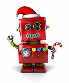Happy vintage toy robot wearing a Santa hat and holding a candy cane.