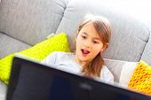 girl surprise looking at the laptop screen