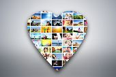 Heart design element made of pictures, photographs of people, animals and places. Conceptual background