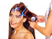 Woman wear hair curlers on head. Isolated,