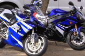 stock photo of crotch-rocket  - Blue Motorcycle Sport bikes parked in the shade - JPG
