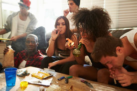 stock photo of gang  - Gang Of Young People Taking Drugs - JPG