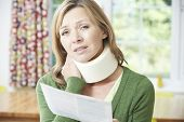 picture of neck brace  - Woman Reading Letter After Receiving Neck Injury - JPG