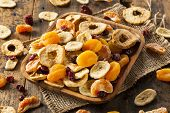 foto of papaya  - Organic Healthy Assorted Dried Fruit on a Plate - JPG