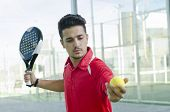 Man Ready For Paddle Tennis Serve
