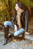 Beautiful Girl Sitting On The Rails