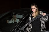 image of starlet  - two women getting out of their car in the night - JPG