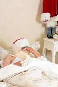 Poor santa claus in bed with the flu or a cold