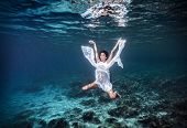 Underwater angel, aqua dance, diving to the beautiful sea bottom, summer vacation, active lifestyle, peace and harmony concept
