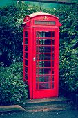 Vintage retro effect filtered hipster style travel image of red English telephone booth
