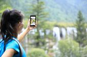 picture of tourist-spot  - woman tourist taking photo with smart phone - JPG
