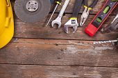 Set of tools over a wooden background