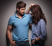 stock photo of she-male  - Handsome muscular fashion man looking at his lover - JPG
