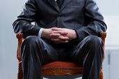 stock photo of won  - old boss or politician sitting on a chair he won - JPG