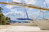 philippino-style wooden sail boat, boracay island, tropical summer vacation