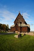 Beautiful view of the Reinli stave church, Sør-Aurdal, Norway, on a clear, bright sky