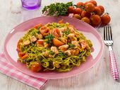 green tagliatelle with fresh salmon and tomatoes