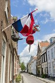 Street With Dutch Flag And Bags