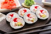 Sushi rolls with tobiko and shrimps