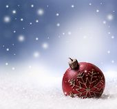 Christmas candle snow and space abstract background.