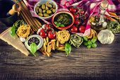 stock photo of pepper  - Italian and Mediterranean food ingredients on old wooden background - JPG