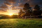 image of sunrise  - Picturesque landscape fenced ranch at sunrise  - JPG