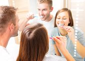 foto of teeth  - Beauty Young couple in the bathroom brushing teeth together - JPG