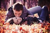 image of hand kiss  - Kissing young couple in love in the autumn park - JPG