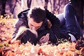 stock photo of hand kiss  - Kissing young couple in love in the autumn park  - JPG