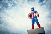 Little boy in superhero costume