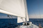 foto of mast  - Mast and hoisted sails of sailing boat - JPG