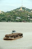 Teak Logs In Timber On Boat In Ayeyarwady River,Myanmar.