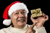 Aged Man With Emphatic Look And Golden Gift